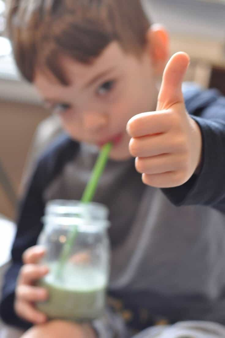 "Young child giving a ""thumbs up"" sign for a traditional diet."