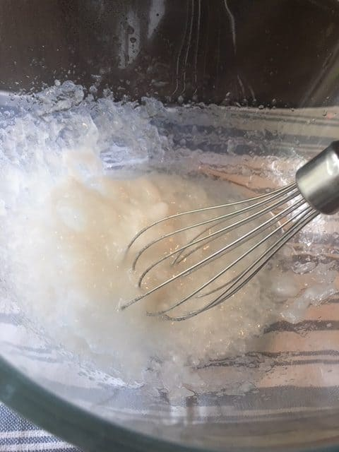 Whipping natural ingredients with an electric mixer to make easy homemade lotion.