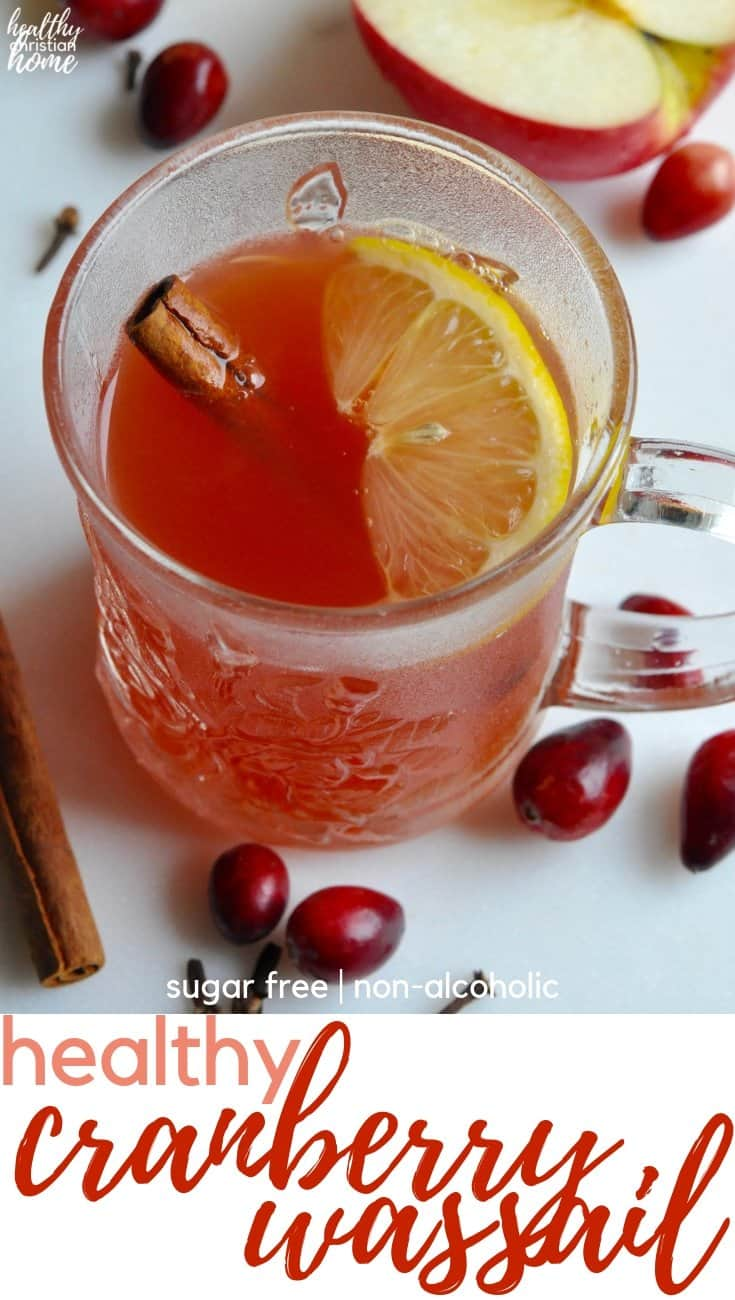 The BEST cranberry wassail recipe with apple, citrus, spices, & tangy cranberry! It's also healthy - non alcoholic & sugar free. Holiday cheer in a cup!