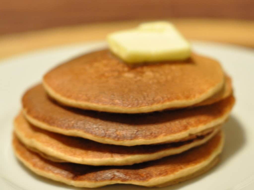 Quick healthy blender pancakes on a ceramic plate.