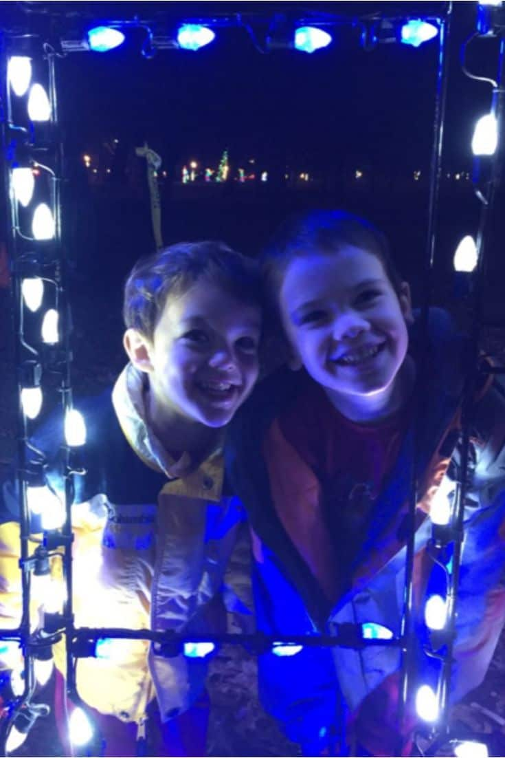 Two children looking at Christmas lights.