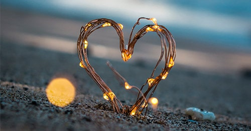 glowing heart in the sand
