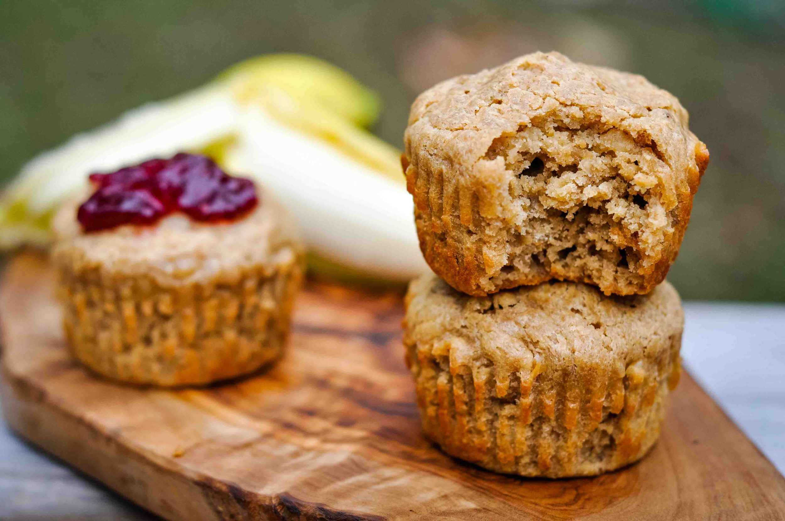 Healthy peanut butter banana muffins on a wooden board.