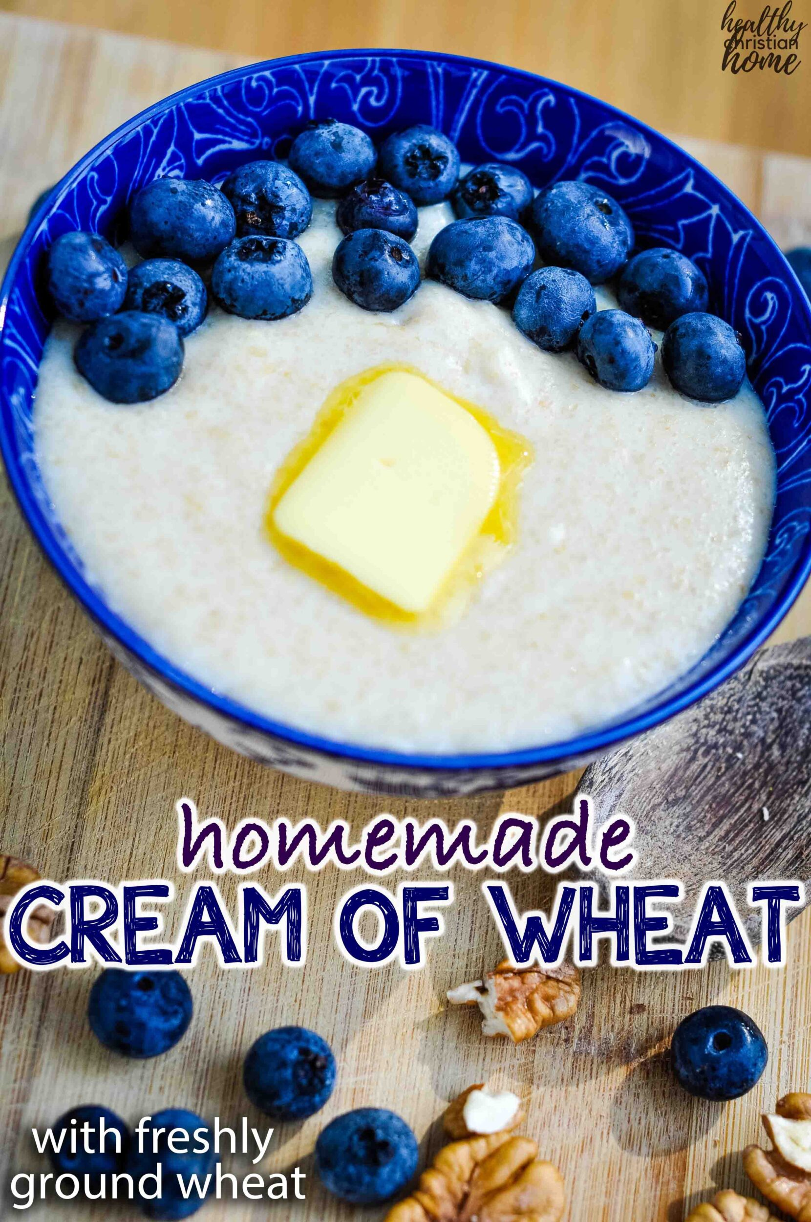 Cream of wheat with blueberries in a blue bowl.